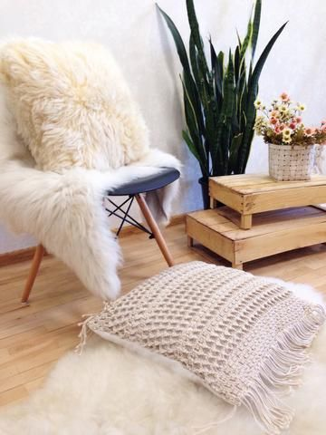 Our large macrame cotton decorative pillow looks amazing with any one of our sheepskin rugs or chair throws! Perfect for your modern home interior, boho home and decor, or nursery decor. Check the link for full product info.