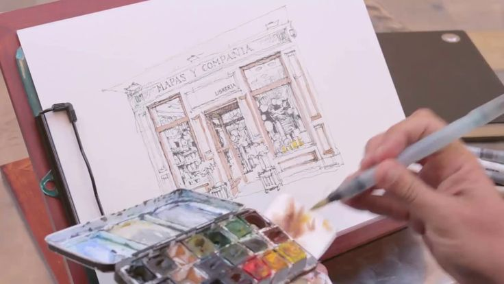 El autor de Málaga, Cuaderno de Viaje - Sketchbook, realiza un dibujo de la fachada de Mapas y Compañía.