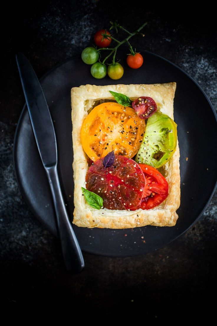 These simple and easy Tomato Basil Tarts with White Bean Puree are a quick meat-free summer meal packed with protein-rich white beans and flavorful heirloom tomatoes and basil.