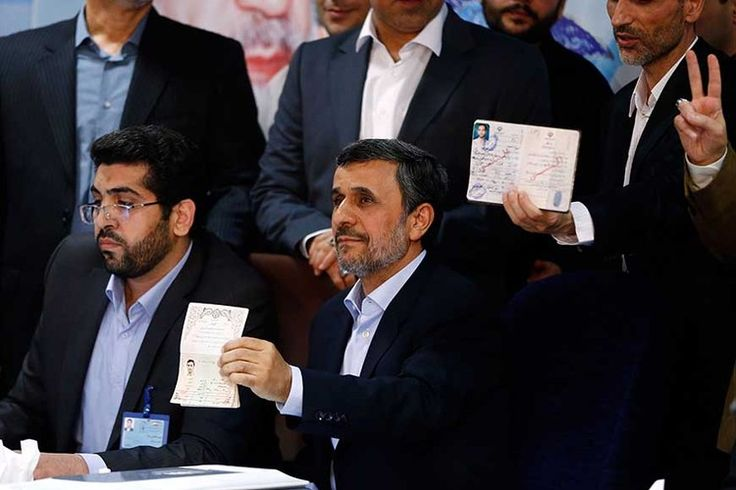 Former Iranian president Mahmoud Ahmadinejad (C) displays identification at the Interior Ministry's election headquarters as candidates begin to sign up for the upcoming presidential elections,Tehran, Iran, April 12, 2017.