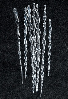 Plastic bottle ornaments - glue Epsom salts on them for texture