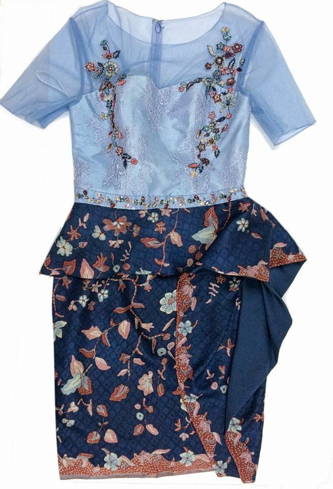 Custom Embroidered Peplum Dress.