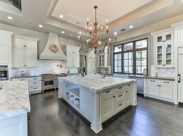 Britney's white kitchen looks ultra-luxurious with marble countertops and a matching backsplash.