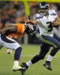 Seahawks Broncos Football - Russell Wilson,  Rafael Bush