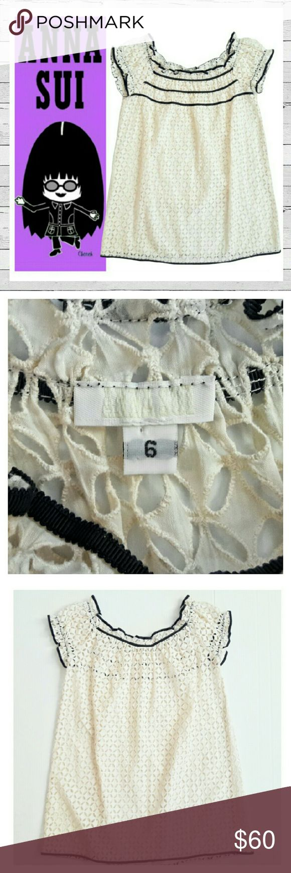 Anna Sui Eyelet Babydoll Top With Grosgrain Trim Fabulous Anna Sui Babydoll top in Ivory with Black Grosgrain ribbon detail. Designed to be layered over contrasting bra or cami. This is a couture piece, not from Target. This is an amazing peice in excellent condition! Sorry no trades. Anna Sui Tops Blouses