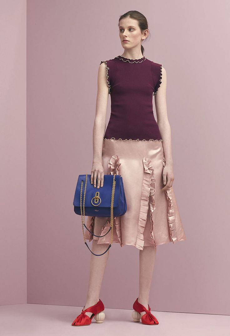 Mulberry Summer '18 LFW show. Anna T-shirt in Prune Micro-Rib Knit, Dora Skirt in Light Candy Glossy Viscose, Draped Pump Shoe in Red Satin and the Marloes Satchel in Cobalt Blue Soft Lamb Nappa Leather.