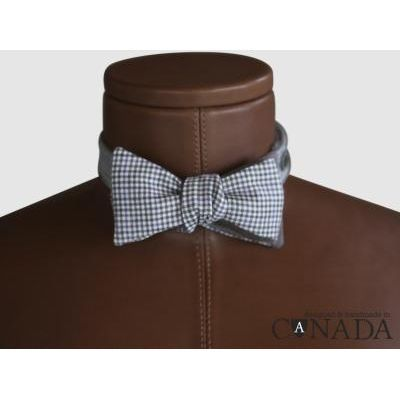This self-tying bowtie is one of a limited edition collection designed to become a keepsake for future generations This reversible composition is made from luxury suiting woollens imported from the United Kingdom and is designed and handmade in Canada Face Super 150's Worsted Wool Back 100%
