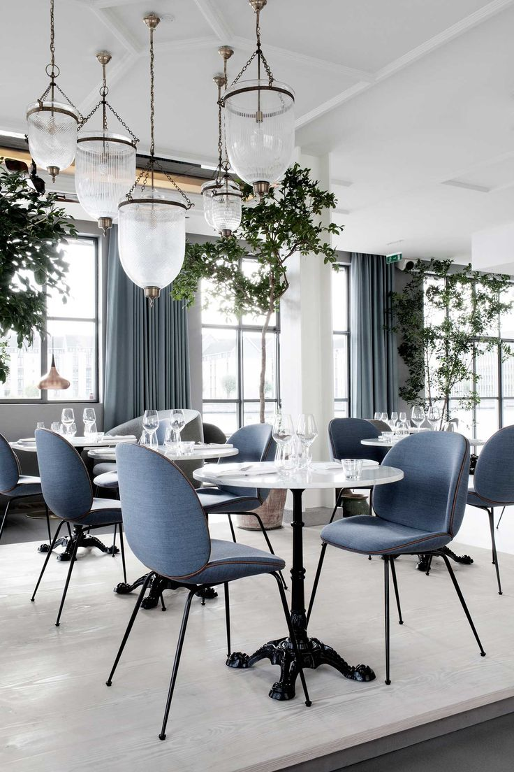 GamFratesi used Beetle chairs from Copenhagen furniture company Gubi paired with classic cast-iron cafe tables.