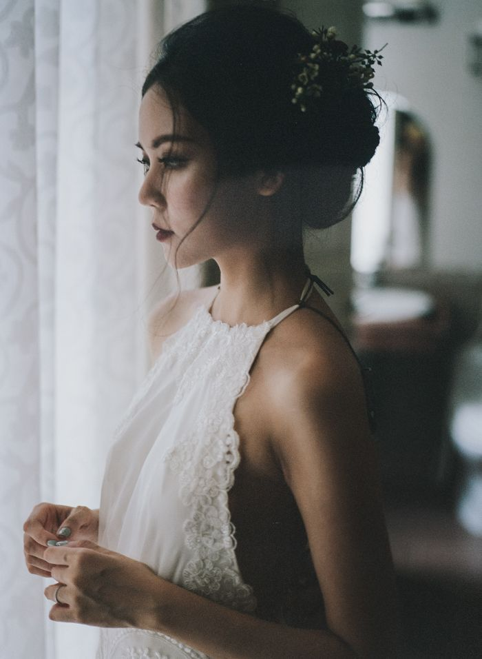 stunning lace halter wedding dress from this Vietnamese wedding   Image by  Tu Nguyen Wedding