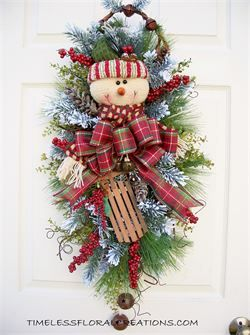 Snowman swag for Christmas or winter decorating. http://www.timelessfloralcreations.com/