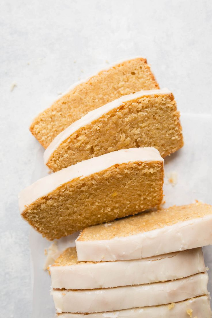 Gluten-Free Iced Lemon Pound Cake recipe made from almond flour, white rice flour, and cornstarch, fresh lemon juice and lemon zest, and coated in a lemon icing glaze. Sweet, tart, and delicious. Gluten-free, dairy-free.