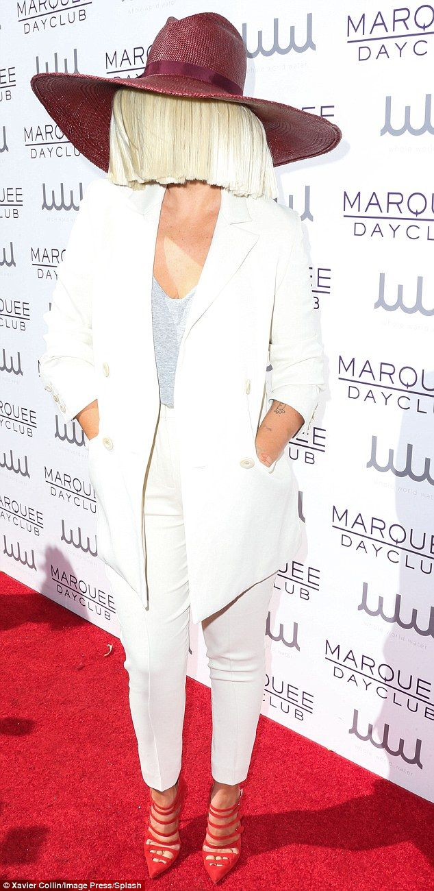 Making a statement! Sia strutted the red carpet at theMarquee Dayclub Preview Party at The Cosmopolitan hotel in her signature style - covering her face with a wig - leaving her sexy heels to make a statement
