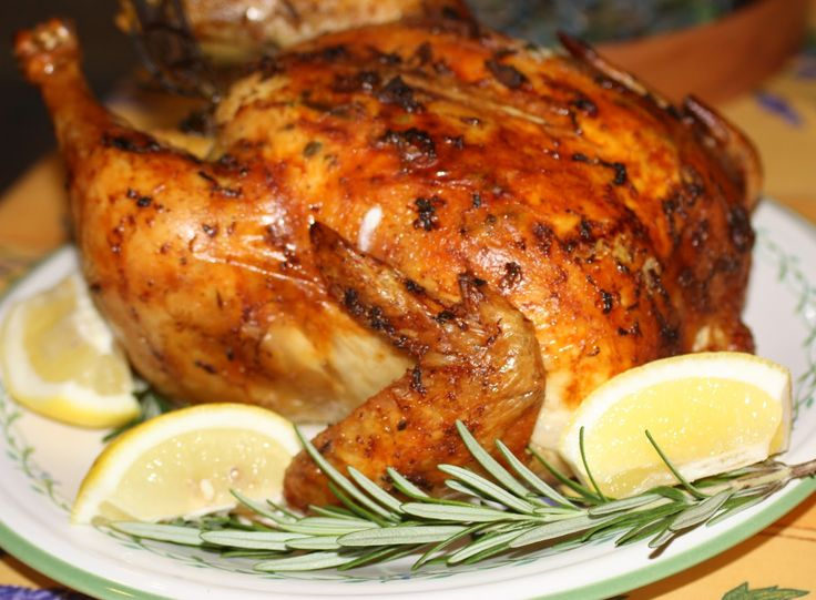 Lemon, Rosemary and Garlic Roast Chicken. Light, Bright and Beautiful! Lemon and Rosemary Chicken! The perfect transitional dish....perfect for where the weather is a little cooler, and summery and citrusy enough for where the weather is a little warmer!  Delicious flavors of lemons, rosemary, and a touch of garlic are the perfect accompaniment to a chicken roasted off to a light golden brown crispiness!  www.creativeelegancecatering.com  www.creativeelegancecatering.blogspot.com