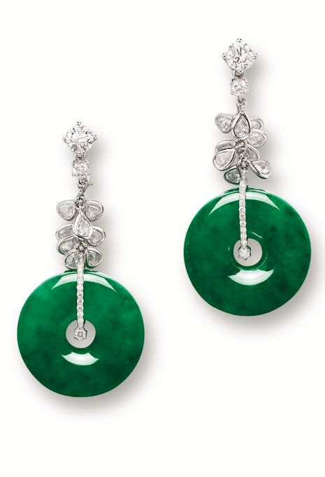 PAIR OF JADEITE 'HOOP' AND DIAMOND PENDENT EARRINGS Each suspending a highly translucent jadeite hoop of emerald green colour, to a surmount set with two brilliant-cut diamonds, linked by numerous pear-shaped diamonds, the diamonds altogether weighing approximately 2.55 carats, mounted in 18 karat white gold.