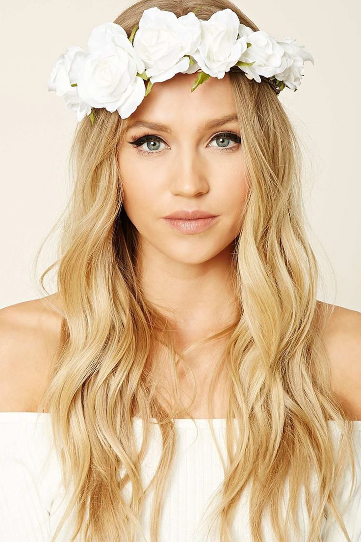 A flower crown headwrap featuring rose embellishments.
