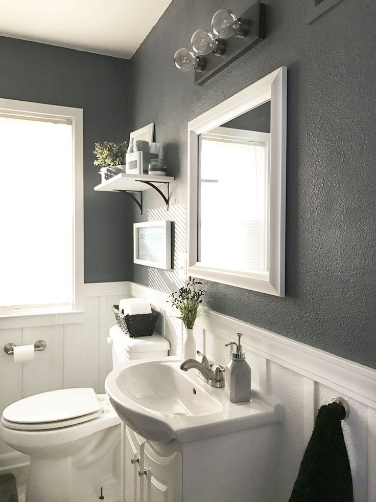 Check out this neutral gray bathroom with white board and batten. Love this One Room Challenge room makeover! It's amazing what you can do to transform a small bathroom.