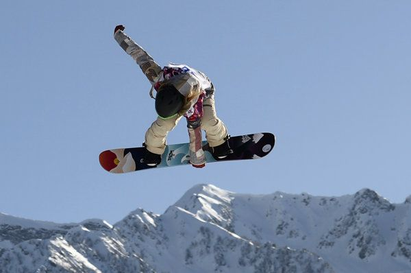 Jamie Anderson and Ty Walker of the U.S. performs jumps during the women's snowboard slope style qualifying session are some of the best 2014 Sochi Olympic Games photos of the day for February 6, 2014.