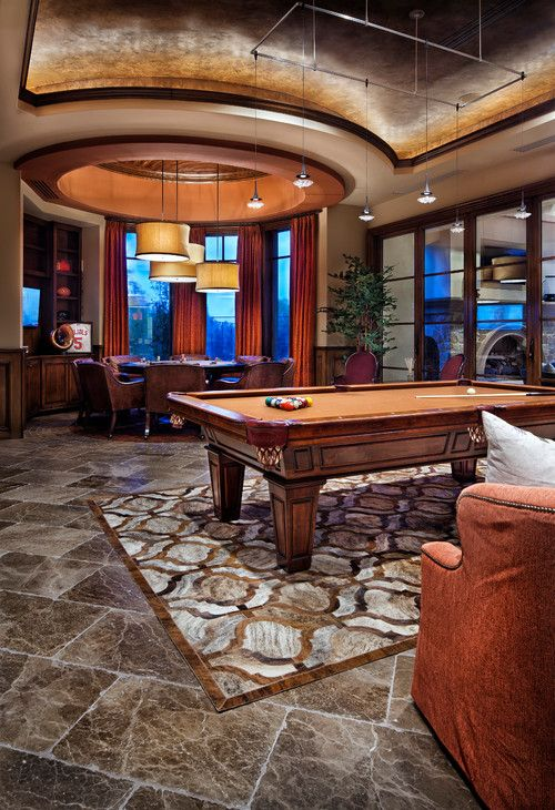 Stunning Mediterranean Family Room complete with a pool and poker table #mancave
