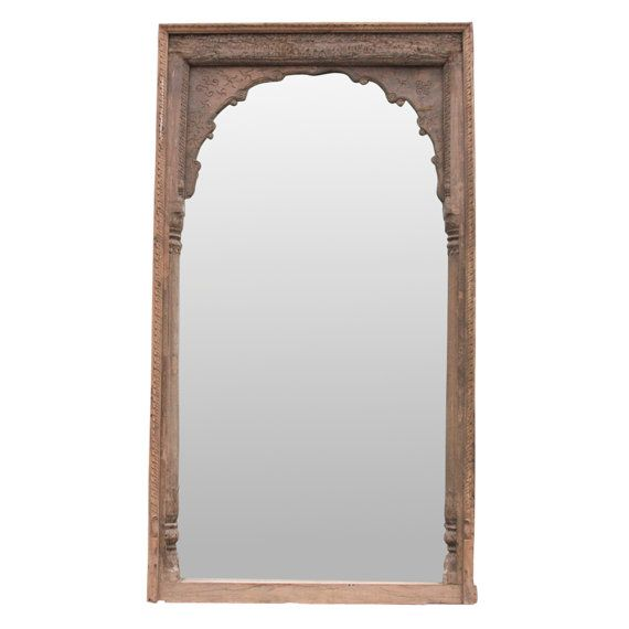 Barmer floor mirror, repurposed from a 19th-century doorway featuring an arched center with intricate carved details, flanked with two finely carved columns with peacock motifs. Original aged brown patina. Minor wear.  Details:  Era: Vintage Dimensions: L=58, D=6, H=105 Material: wood/glass Color: brown Condition: good  White Glove Shipping quote is $ 499 to most US Cities ( Excludes Hawaii & Alaska ). Price might suffer minor changes once we receive Final shipping destination.  Approximate…