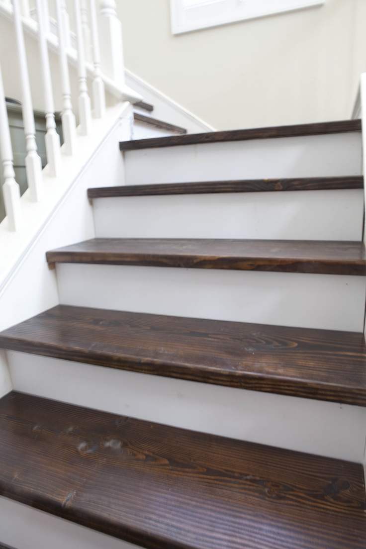 New stairs. My husband rebuilt each step, sanded, stained, etc. #farmhouse #stairs