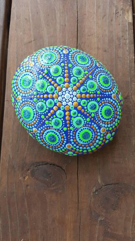 Check out this item in my Etsy shop https://www.etsy.com/listing/557147233/big-mandala-rockpainted-rockpainted