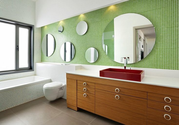 Fabulous use of green tile in the contemporary bathroom. Scale this all down in your mind's eye to a space say 1 metre by 2.5m, (or 3ft 2ins, by 8ft) and it would still work, but you would have to keep the colour palette 'percentages' just the same to make it work - oh, and without the red basin - as that would constrict the eyeline, somewhat in a tiny house bathroom.