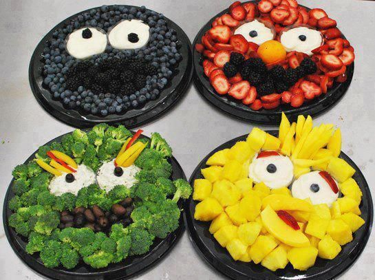 Sesame Street fruit and veggie trays! Except I did Elmo with red peppers and black olives, Oscar with mini cukes, black olives and portabella mushrooms (his eyebrowns are BROWN)