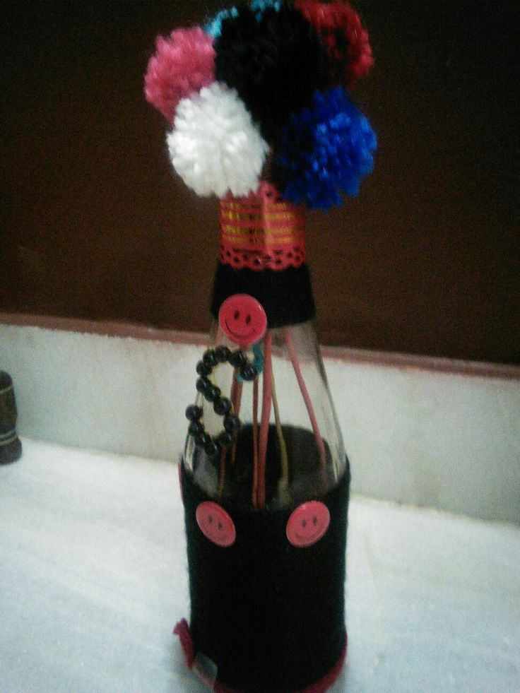 Bottle decoration with yarn n pearl.