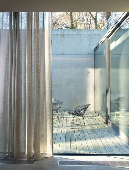 Polished concrete. Modern linen curtains. Fabric and curtains sold by Decorators Market