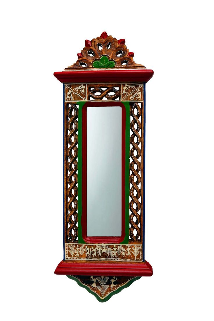 Adorn this aristocratic Wall Mirror, magnificiently handcrafted from Mango wood with excellent finish. This ethnic mirror stands out for sheer aesthetic. The multicoloured Jharokha Wall Mirror dresses up your hallway and bedroom with it's unique designs and carving which adds a twist of elegance with Warli Art and redecorates the area. A hook has been attached at the back which allows the mirror to be mounted vertically on the wall. The glass has been carefully assembled with particular…