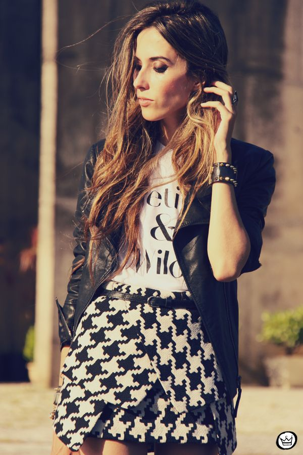Get creative and mix a structured houndstooth skirt with a punk leather jacket.