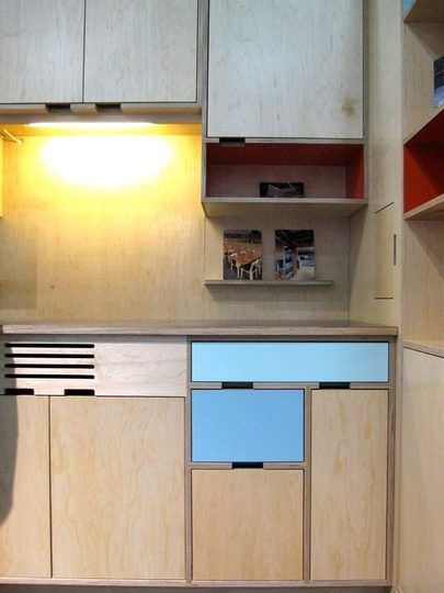 Nice use of plywood for cabinets. The painted doors are reminiscent of Finn Juhl's storage pieces.