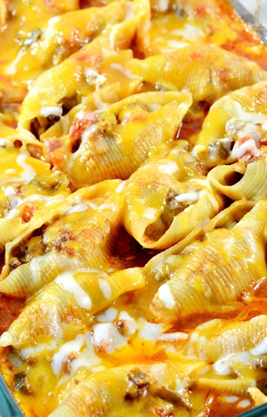 Mexican Stuffed Shells Recipe ~ filled with a ground beef and cream cheese mixture, cooked in a bath of enchilada sauce and salsa topped with cheddar cheese. Or make it vegetarian