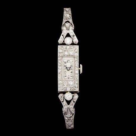 ARMBANDSUR, briljant- och åttkantslipade diamanter, tot. ca 1.20 ct, ca 1920-tal.  Platina, senare armband i vitguld. Manuellt. L. 18,5.