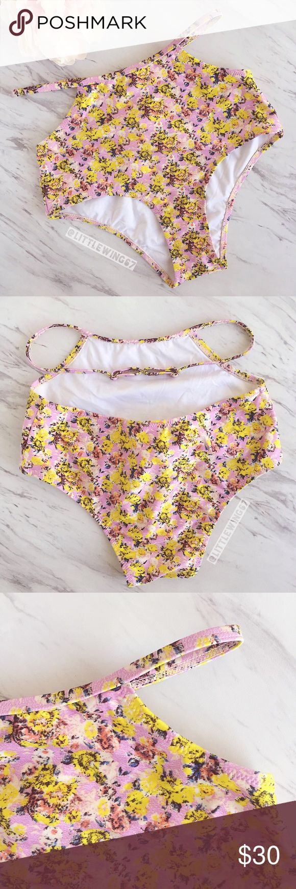 Somedays Lovin floral high-waisted bikini bottoms Somedays Lovin | These high-waisted bikini bottoms feature a fun floral print in pink and yellow. Cut-out detail with adjustable waist strap. Pair these retro-inspired bottoms with your favorite bikini top and a fluttery off-the-shoulder top for a beach-ready look! Never worn; hygienic liner still intact. NWOT.   Size: XS Somedays Lovin Swim Bikinis