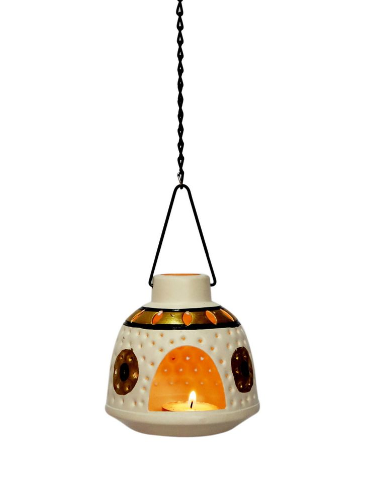 This White and Gold hand painted metallic tea light holder is a new and ethnic concept in modern households. It comes with a detachable chain hence it can be hung as well as kept inside the house. Beautiful crafting on it enables spread of light in all directions, making the surroundings aesthetically pleasing. Will get delivered with two tailored made tea lights.