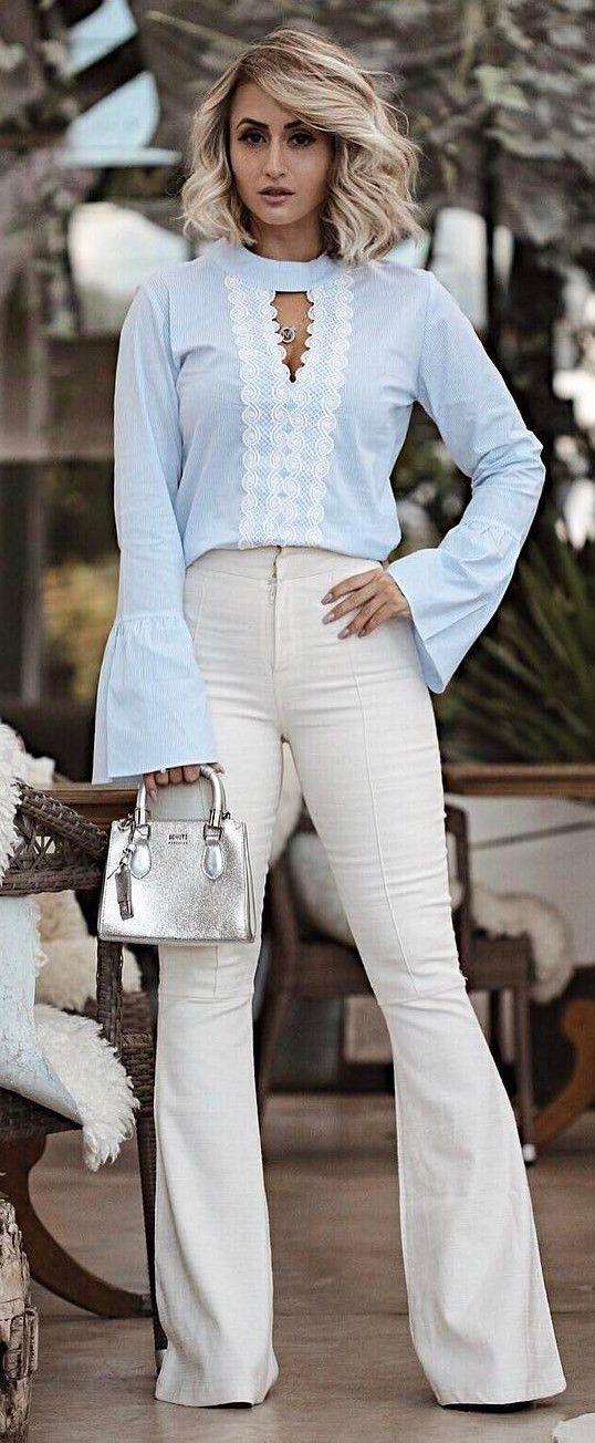 blue top + white pants + bag