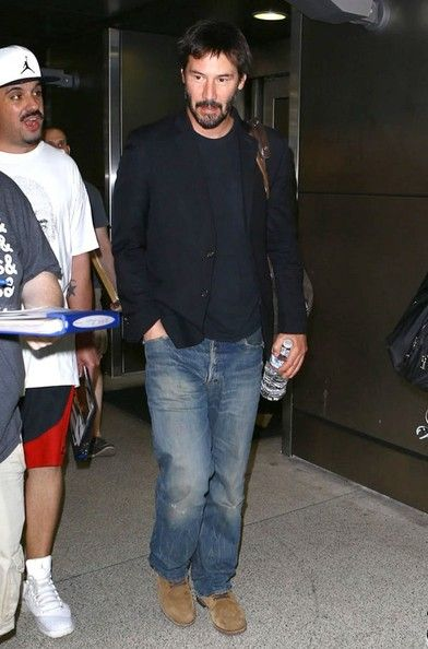 Keanu Reeves Photos Photos - 'John Wick' actor Keanu Reeves arriving on a flight in Miami, Florida on October 8, 2014. Keanu secured a temporary restraining order against alleged stalker Kerry Colen Raus who was found at his Los Angeles home after she had swam in his pool and took a shower in his house. - Keanu Reeves Arriving On A Flight In Miami