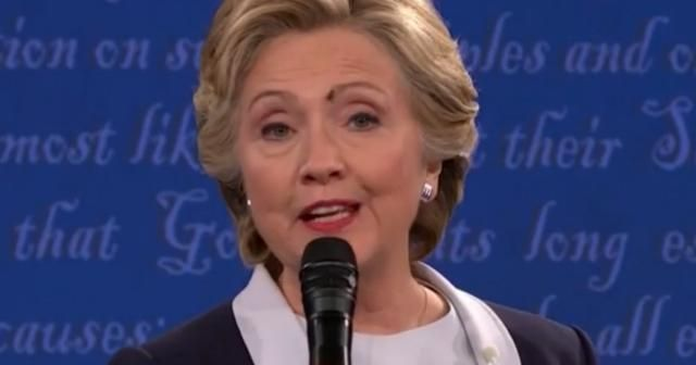 Was fly sending message when it landed on Hillary Clinton's face?