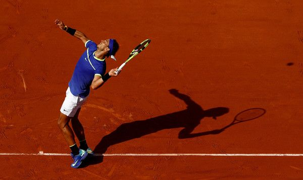 Rafael Nadal Photos Photos - Rafael Nadal of Spain serves during the second roun match against Robin Haase of The Netherlands on day four of the 2017 French Open at Roland Garros on May 31, 2017 in Paris, France. - 2017 French Open - Day Four