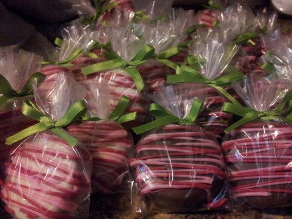 This listing is for 1 dozen (12) hand dipped White Chocolate Covered Oreos drizzled with red and pink chocolate. Oreos will be packaged as