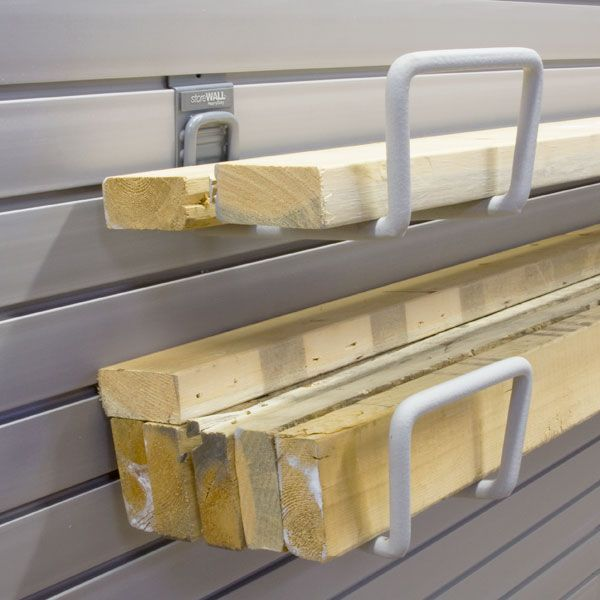 Garage Storage Ideas   Organize lumber, pipes or trim with a pair of Utility hooks .