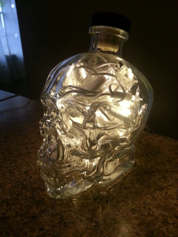 Lamp out of crystal skull vodka bottle and Christmas lights