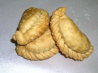 empanadas- Iused to go to Marini's Empanada House with my cousins, Betty Jo & Rick back in the 70's.  They closed down and have re-opened many years later.  It's on my 'to-do' list when I go to Houston.  They were great!