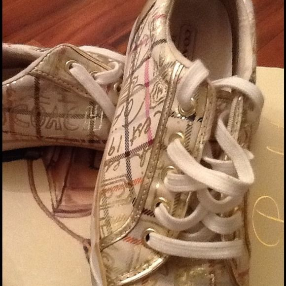 Hot Coach tennis shoes!!!! Popular Coach tennis shoes!! Multiple colored accented in gold... Coach Shoes Athletic Shoes