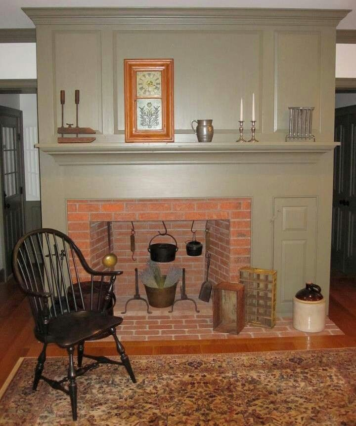 FARMHOUSE INTERIOR Vintage Early American Farmhouse Showcases Raised Panel Walls Barn Wood Floor Old FireplaceLiving Room