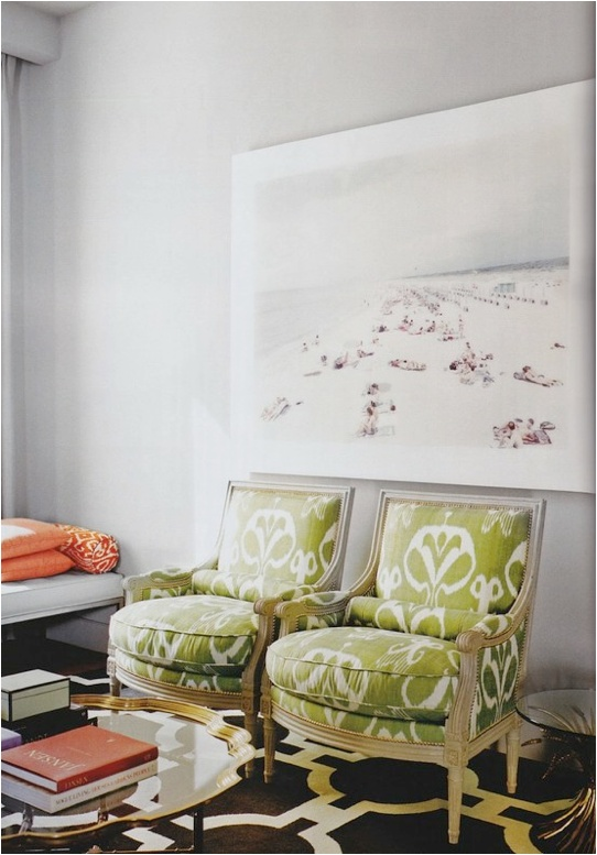 Love those green chairs and that coffee table!