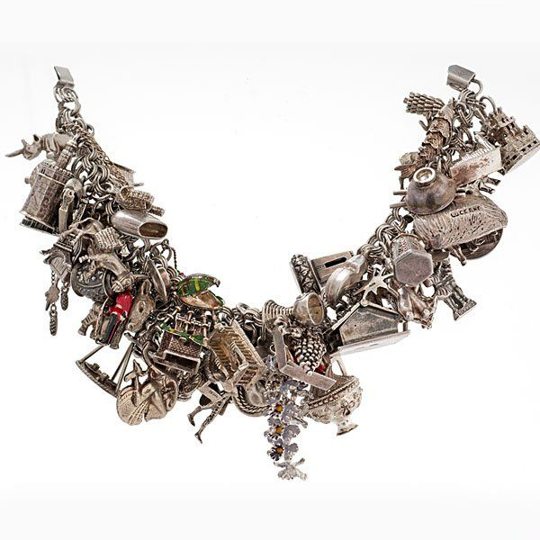 Elaborate Sterling Silver Charm Bracelet  Vintage sterling silver charm bracelet with a full set of charms, including mechanical can-can dancers, a hinged roof house, moveable windmill, tourist keepsakes, and articulated fish. 126dwt.