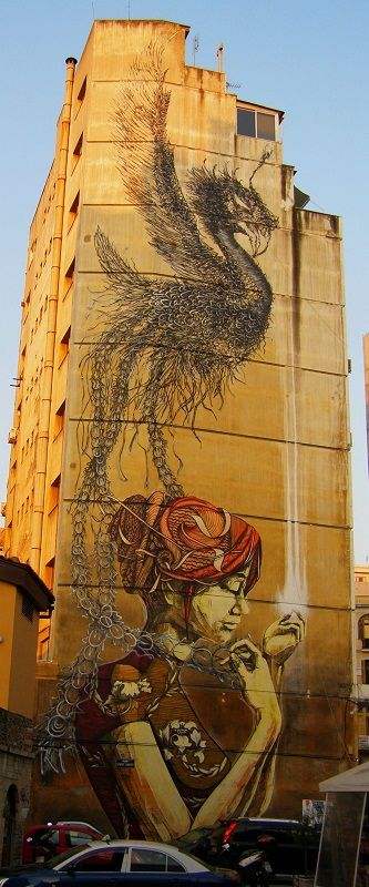 A marvelous street art in Thessaloniki  I count approoximately 9 - 10 stories... whose got the ladder. ..scaffold...parachute  Wow