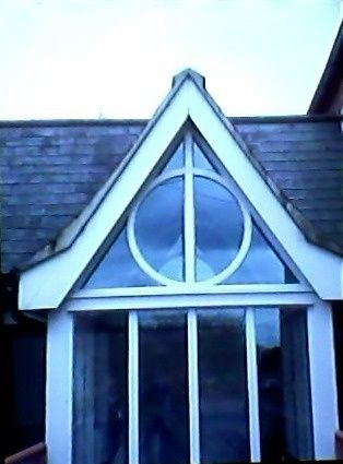 Oh my god!!! I LOVE it. The deathly hollows from Harry Potter hidden in the architecture. I need this!